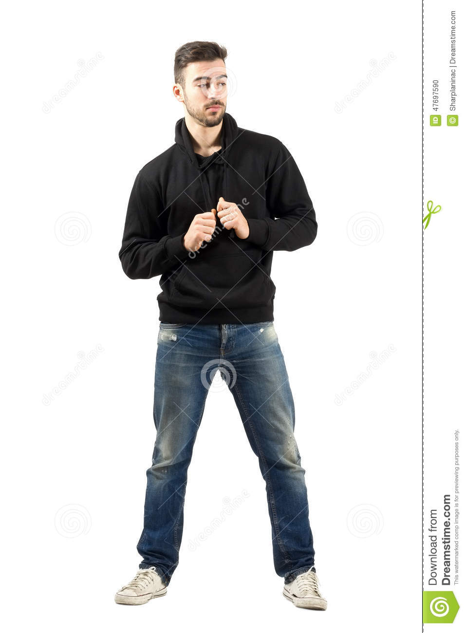 full body hoodie young man holding hoodie strings looking down stock photo 6071