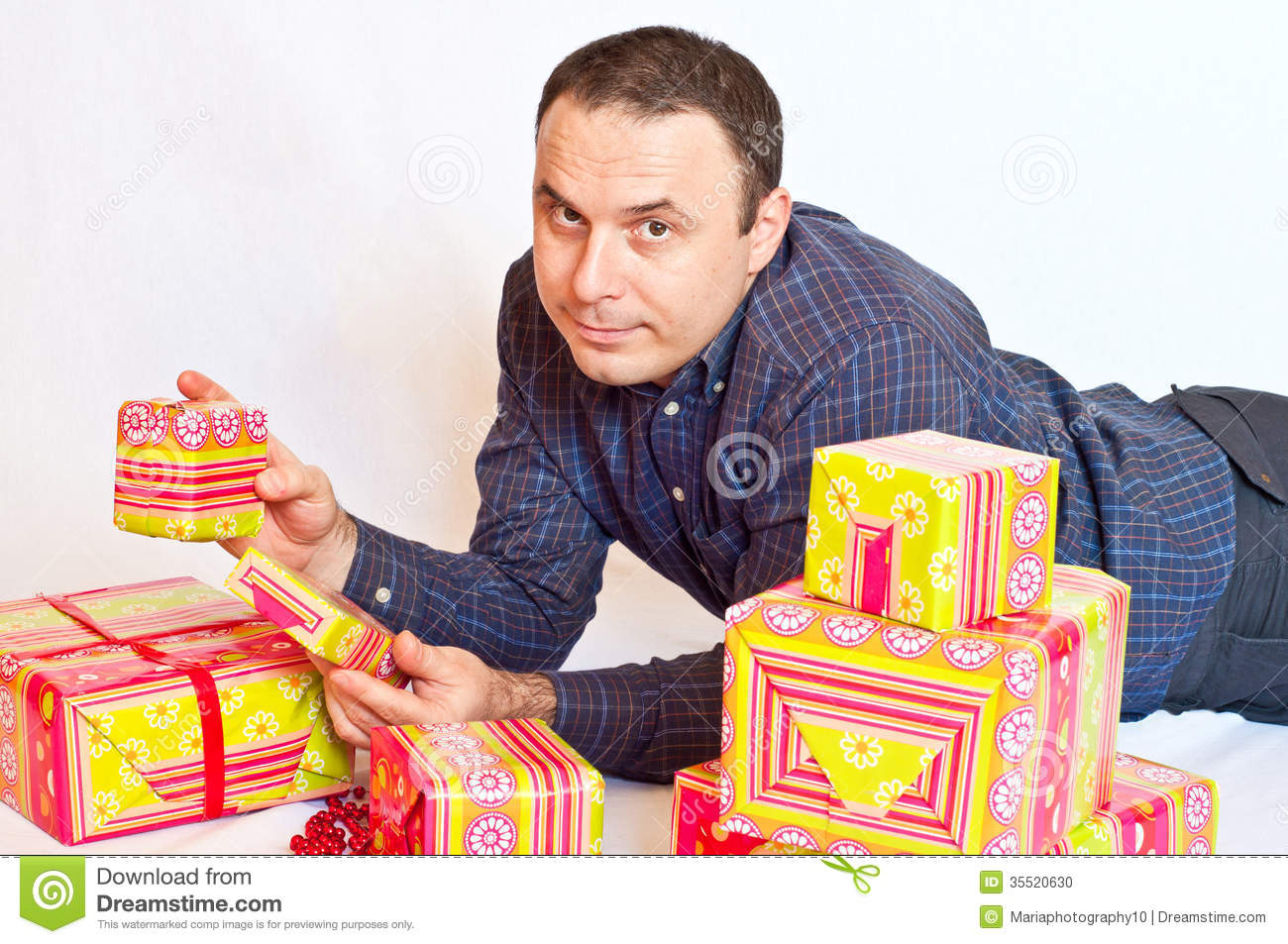 Young Man Holding Some Gifts Stock Photo Image 35520630