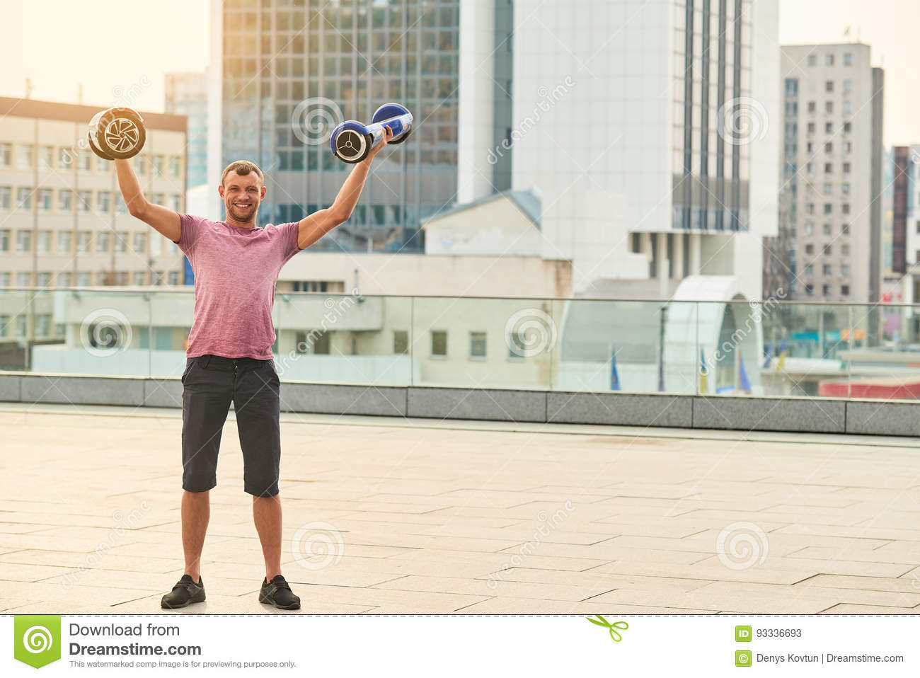 Young Man Holding Two Gyroscooters Stock Image Image Of Modern Electric 93336693