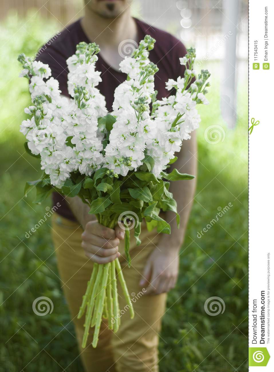 Young Man Holding White Flower Bouquet At His Back Wooden Brown