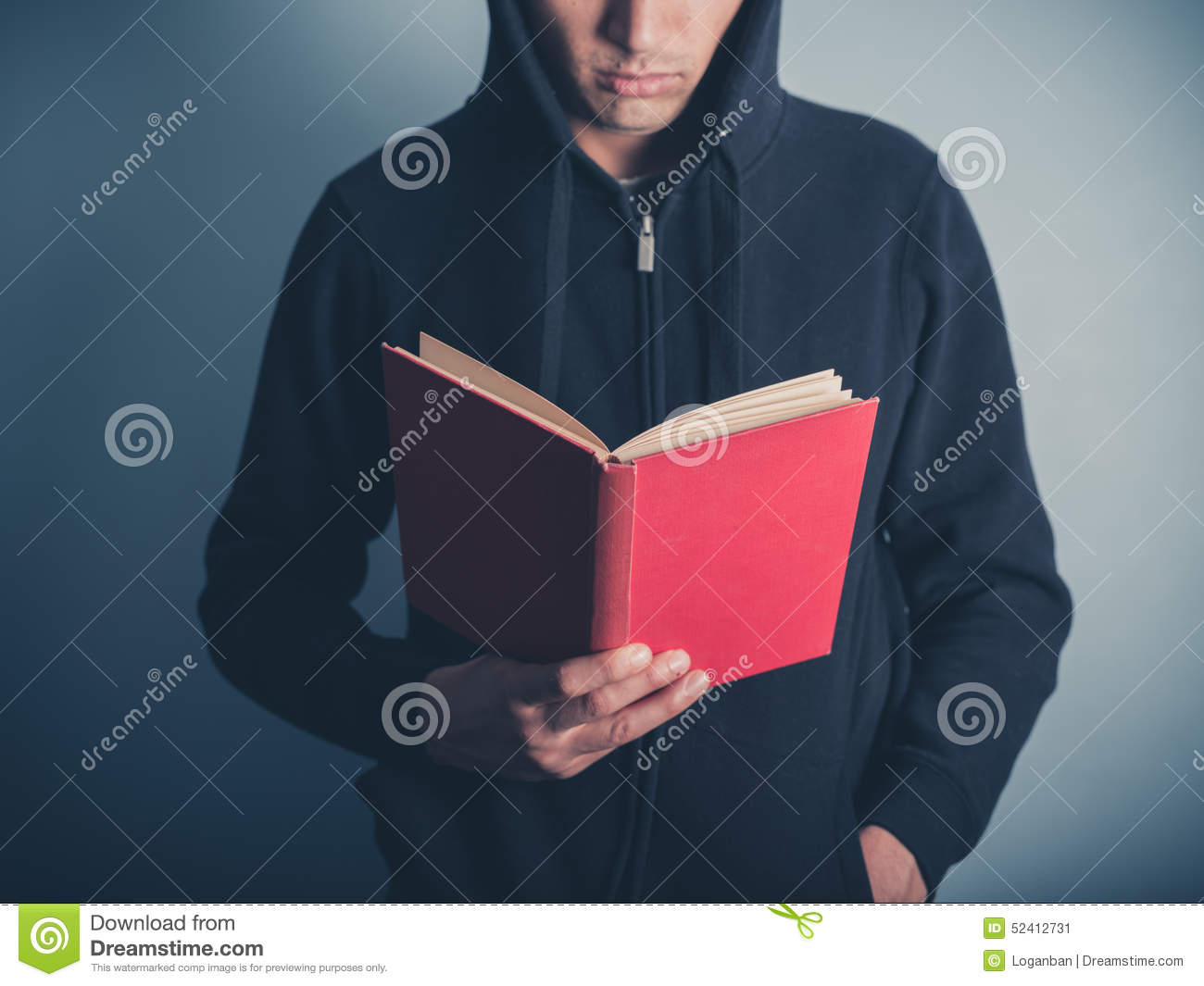 Young Man In Hooded Top Reading Red Book Stock Image ...