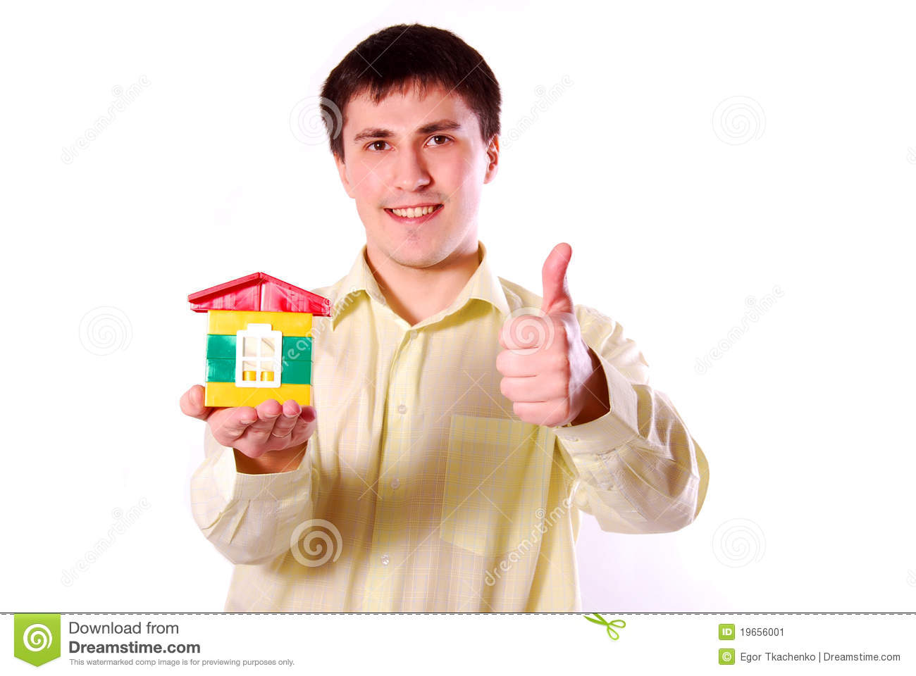 Young man with house s model.