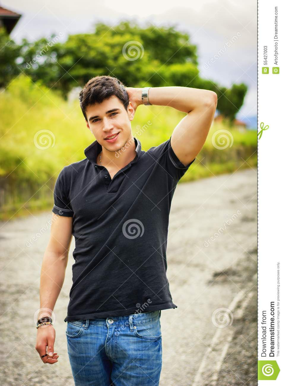 Black t shirt and jeans - Young Man In Jeans And Black T Shirt Walking Along