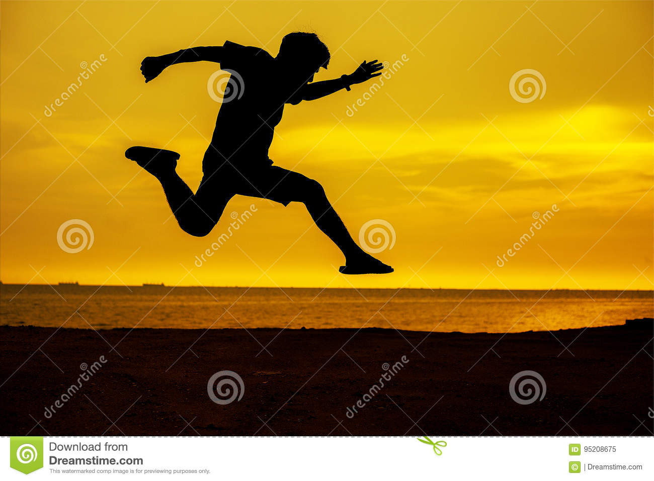 young man jump over the sun and through on the gap of hill silhouette evening colorful sky.