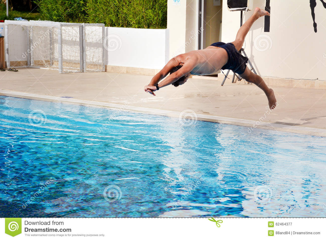 Young Man Jumping In The Swimming Pool Stock Image Image Of Diving Bubbles 62464377