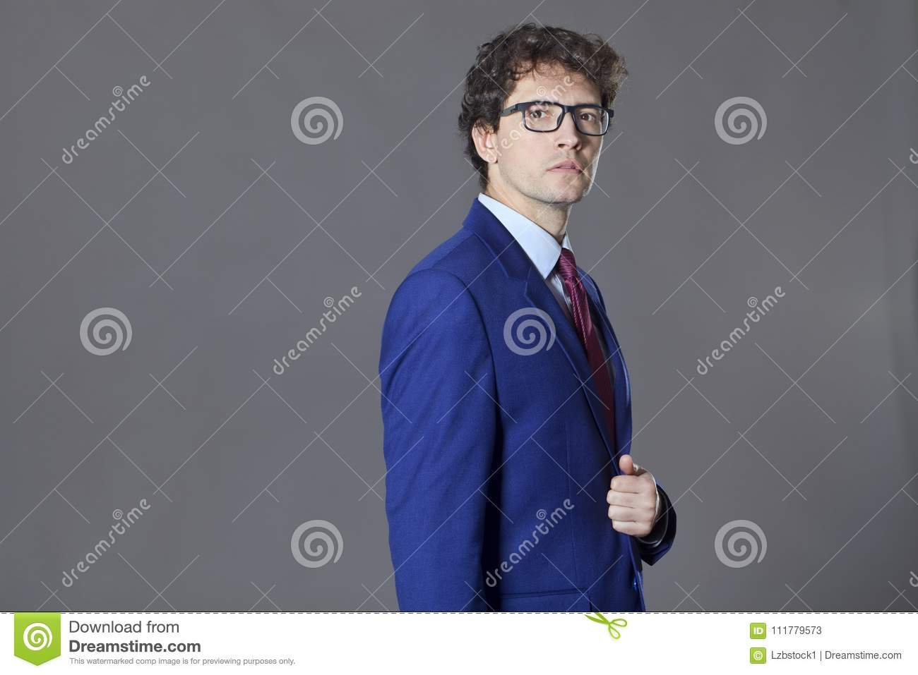 Young man keeping his blue jacket