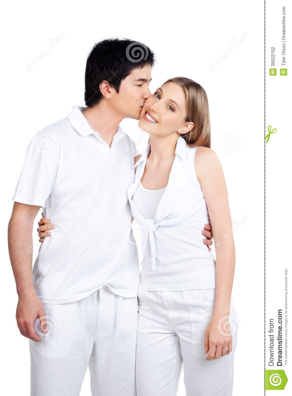 Young Man Kissing Young Woman