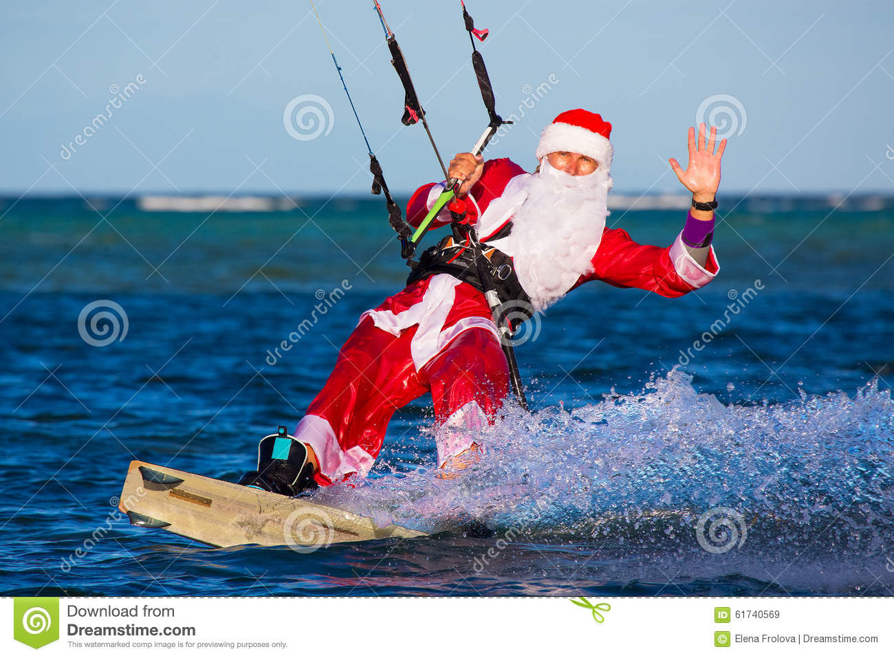 Young Man On The Kite In The Costume Of Santa Claus Christmas A