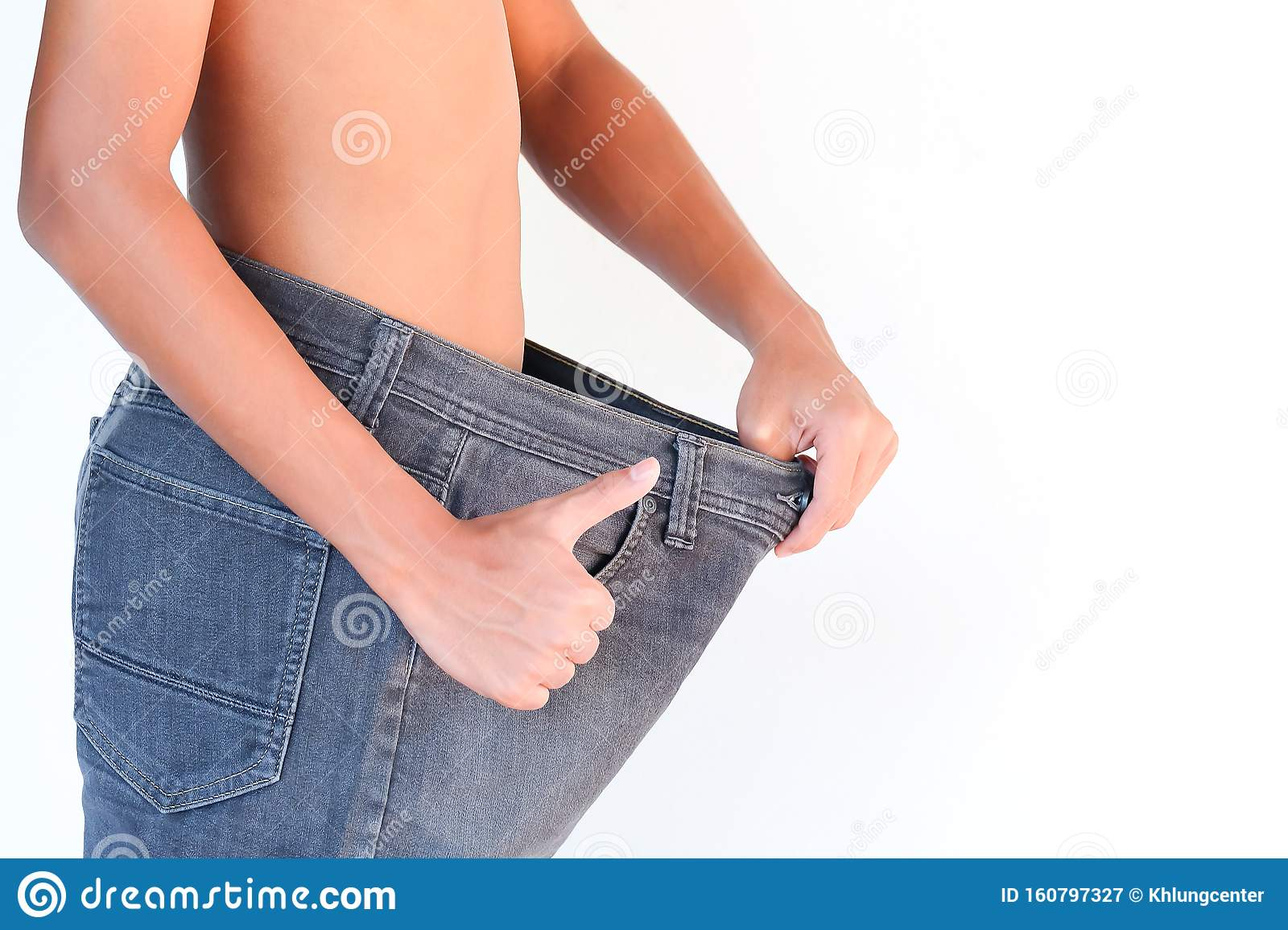 Young Man In Loose Jeans On White Background Weight Loss Concept Stock Image Image Of Female Thin 160797327