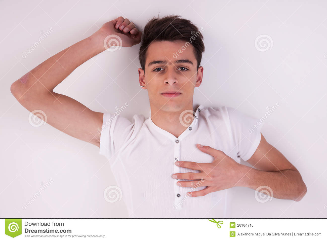 Young man lying on the floor thinking stock photo for On the floor