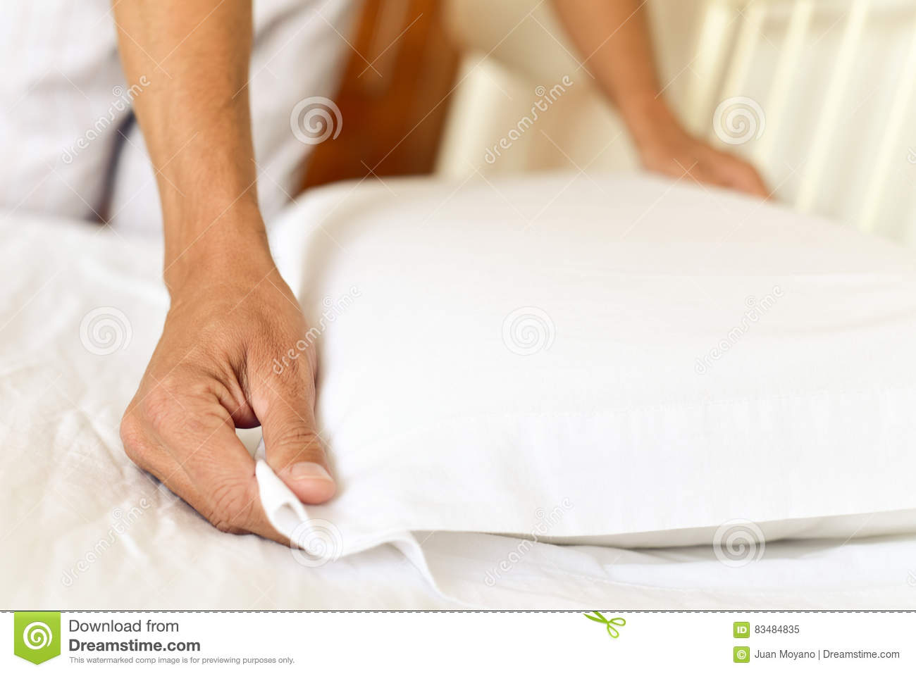 Young man making the bed