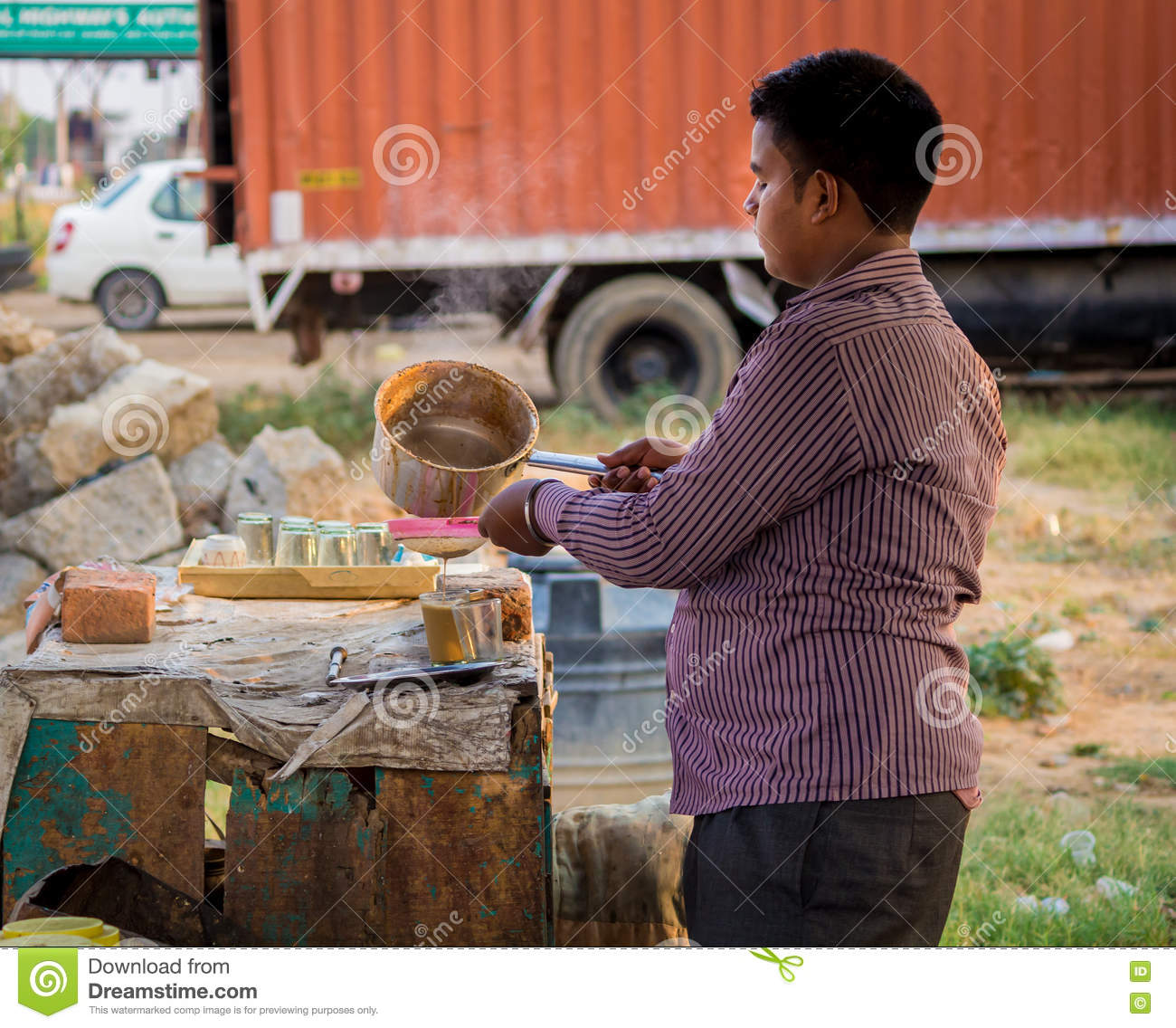 A young man making a tea