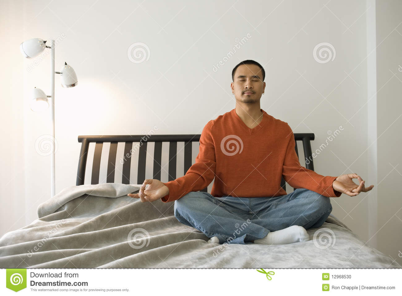 Young man meditating in bedroom stock photo image 12968530 - Man bedroom photo ...