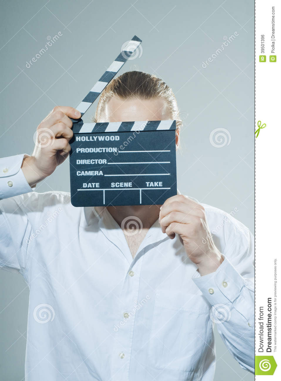 Young man with movie clapper