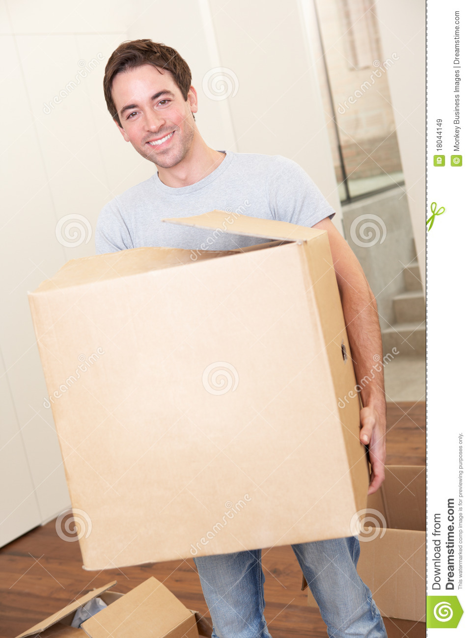 young man on moving day carrying cardboard box stock image image of enjoy carry 18044149. Black Bedroom Furniture Sets. Home Design Ideas