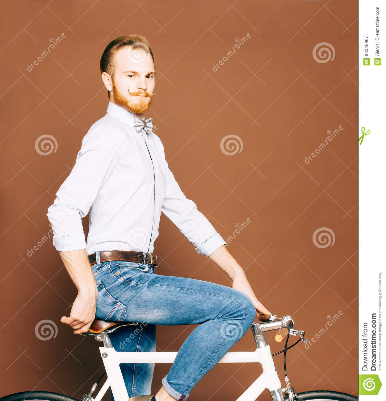 A Young Man With Mustache And Beard Is Sitting On A ...