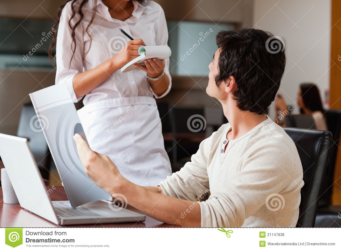 Young Man Ordering Food To A Waitress Royalty Free Stock