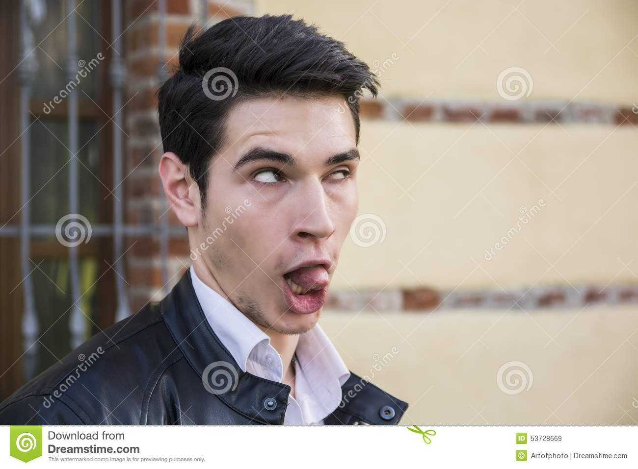 Young man outdoor doing silly face and stupid