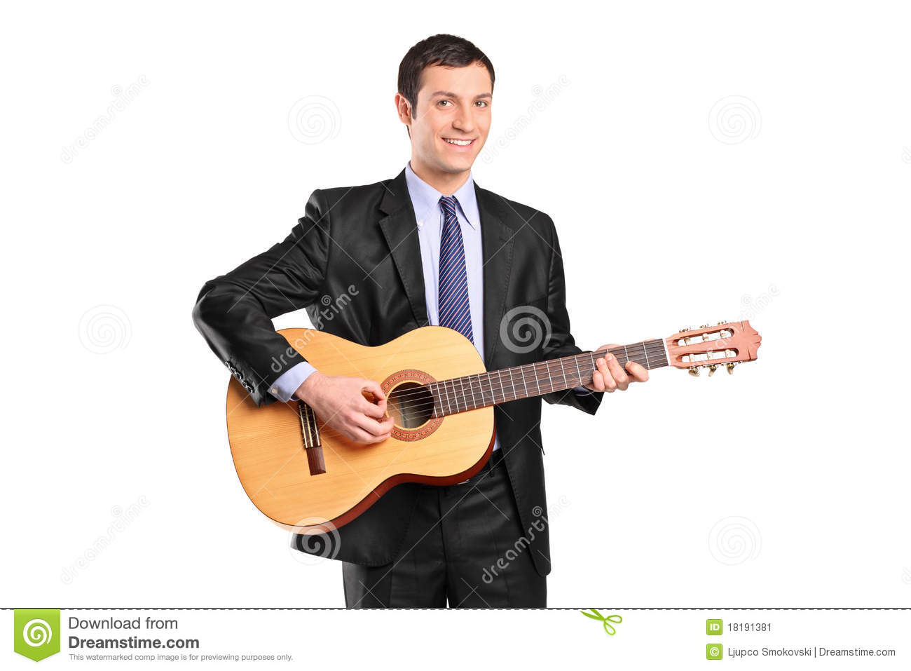 A Young Man Playing Acoustic Guitar