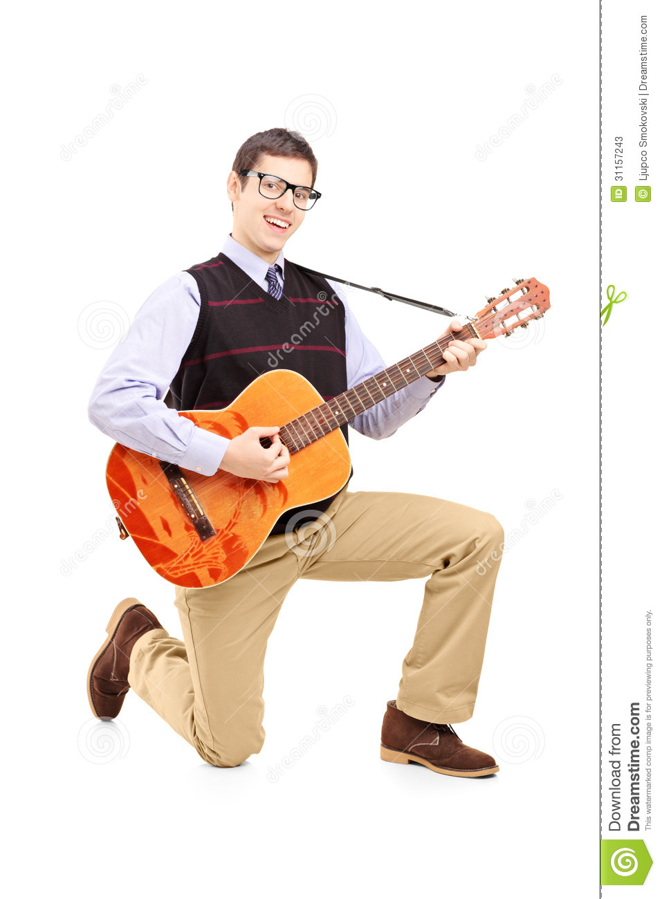 Young Man Playing An Acoustic Guitar And Kneeling Stock ...