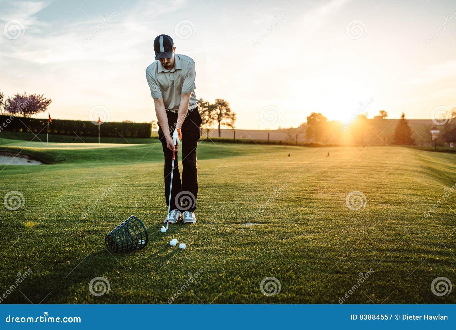 Download Young man playing golf stock image. Image of people, orange - 83884557