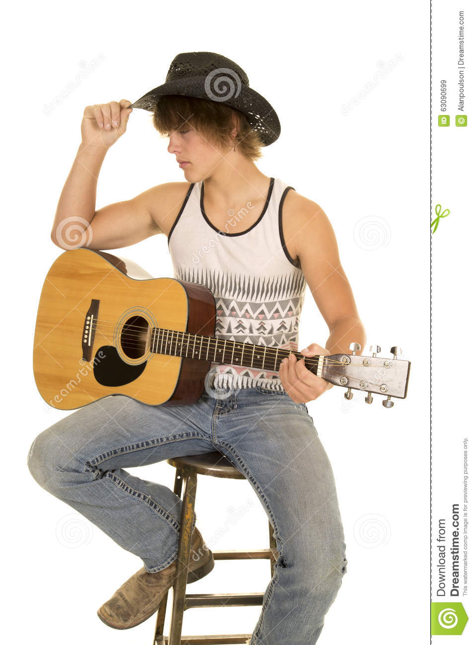 Royalty-Free Stock Photo. Download Young Man Playing A Guitar ...  sc 1 st  Dreamstime.com & Young Man Playing A Guitar With Cowboy Hat Sit Stock Photo - Image ... islam-shia.org