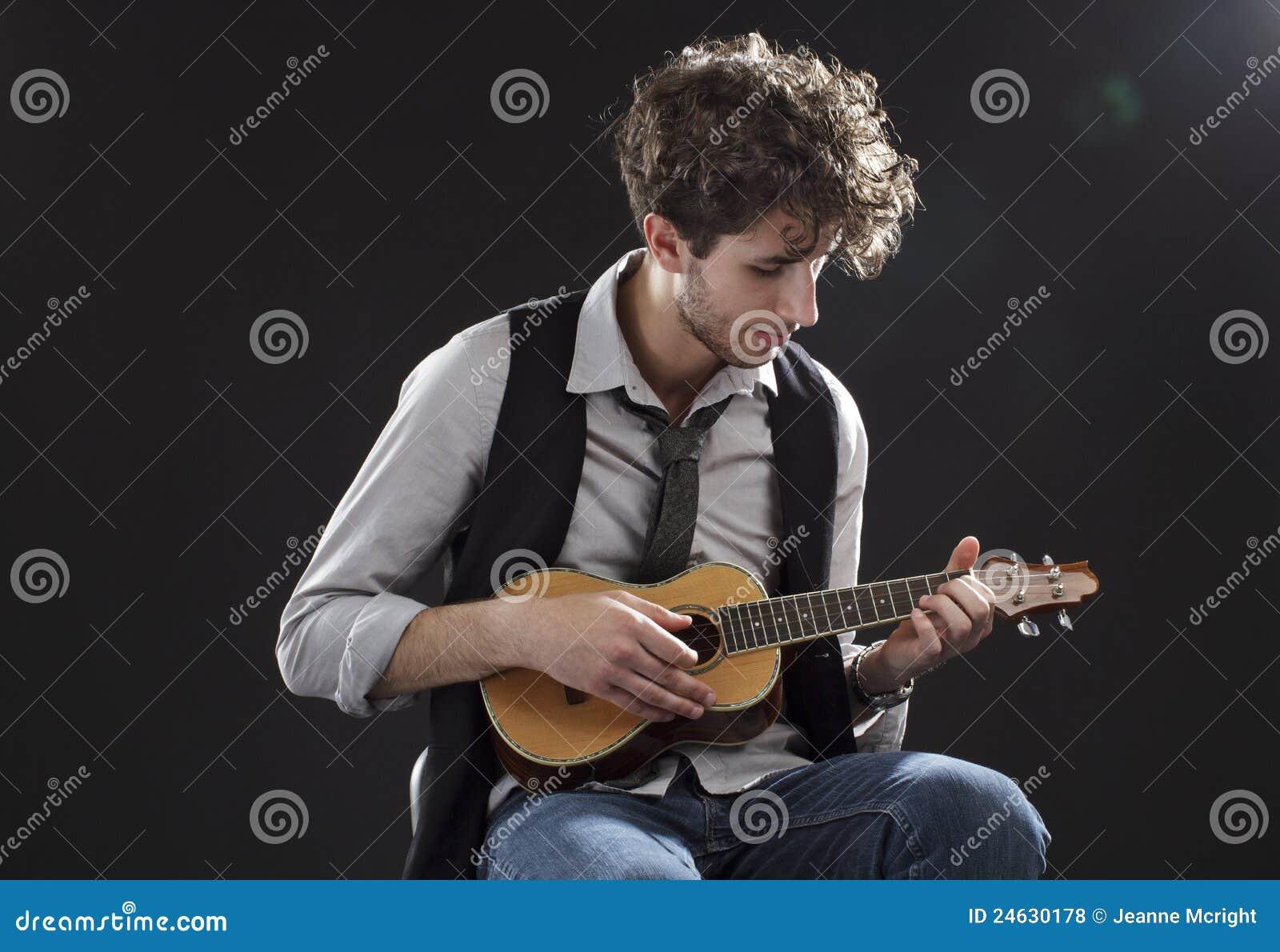 Young Man Playing A Ukulele Stock Photo - Image: 24630178