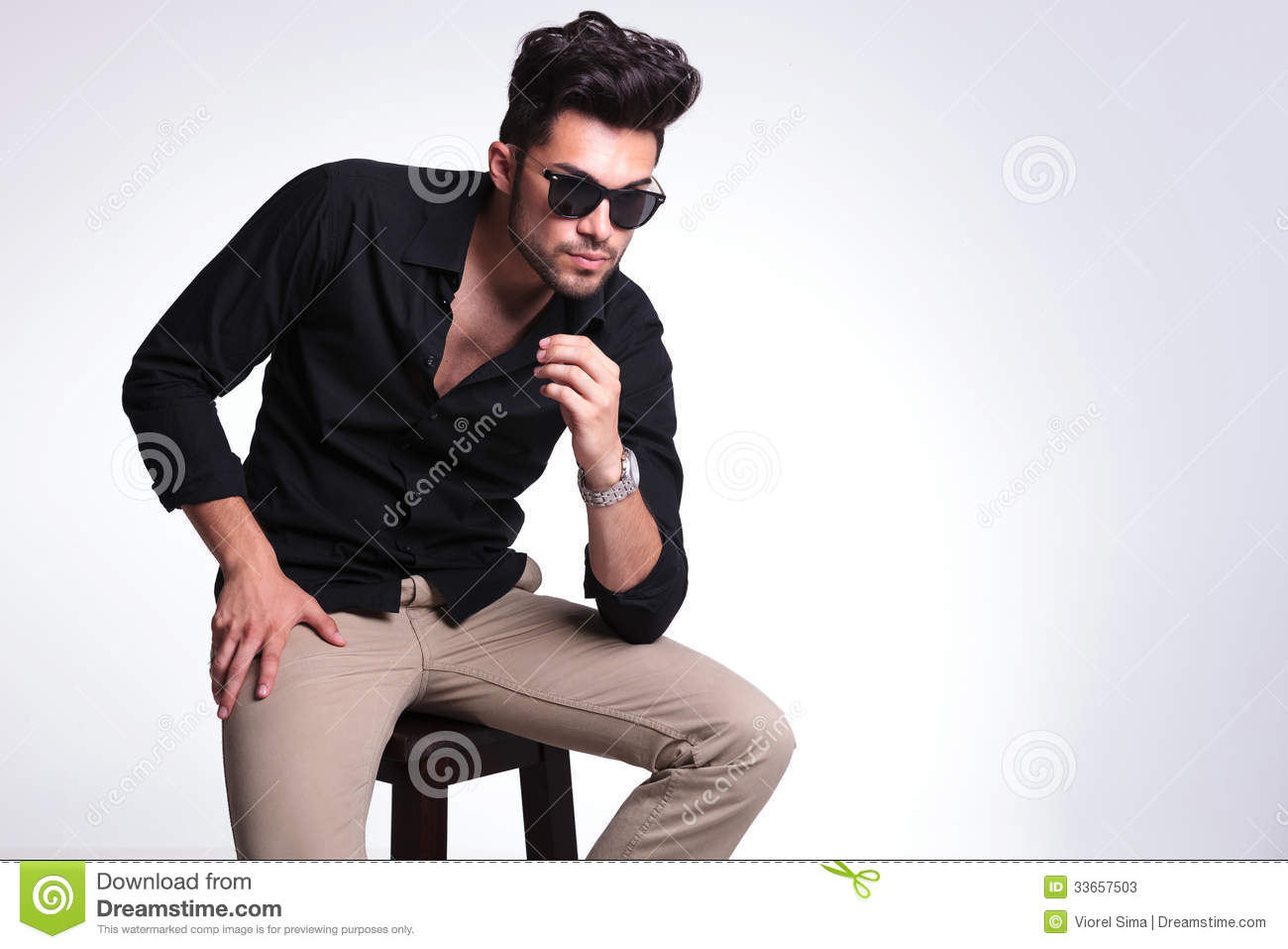 Young Man Posing On Chair Looking Away Stock Image Image Of Beard Away 33657503
