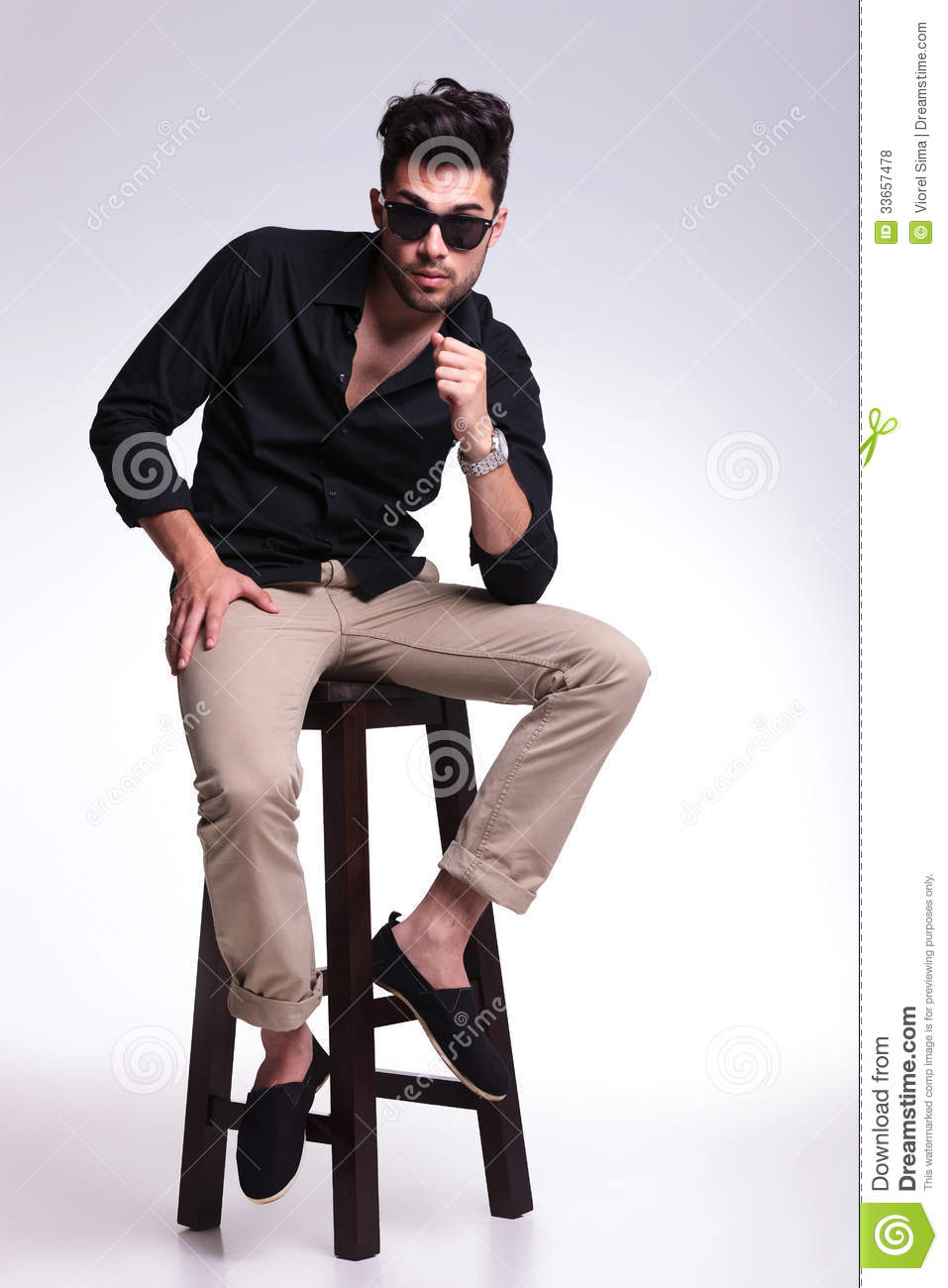 Young Man Posing On A High Chair Stock Photo Image Of