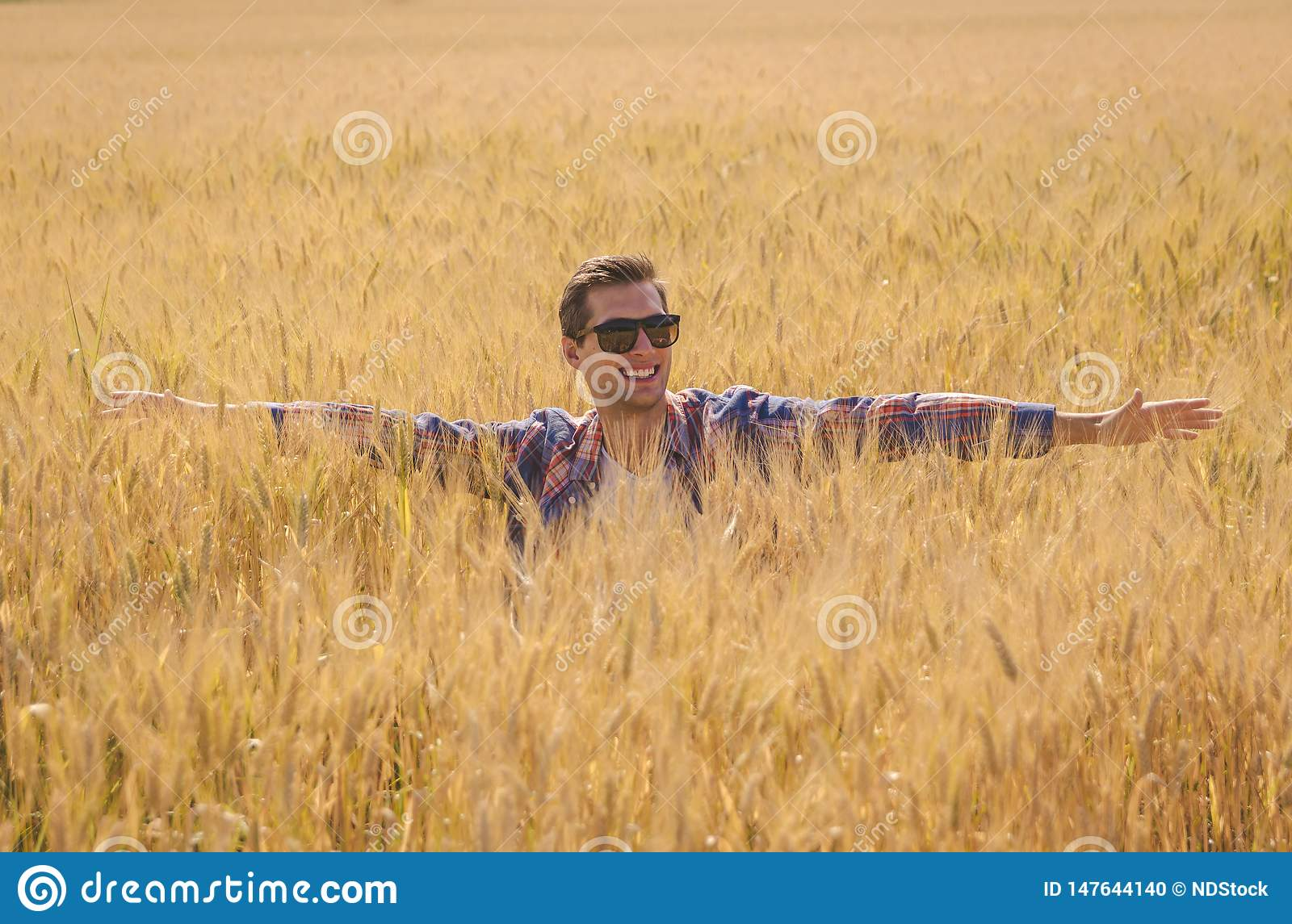 Man posing in a Wheat filed