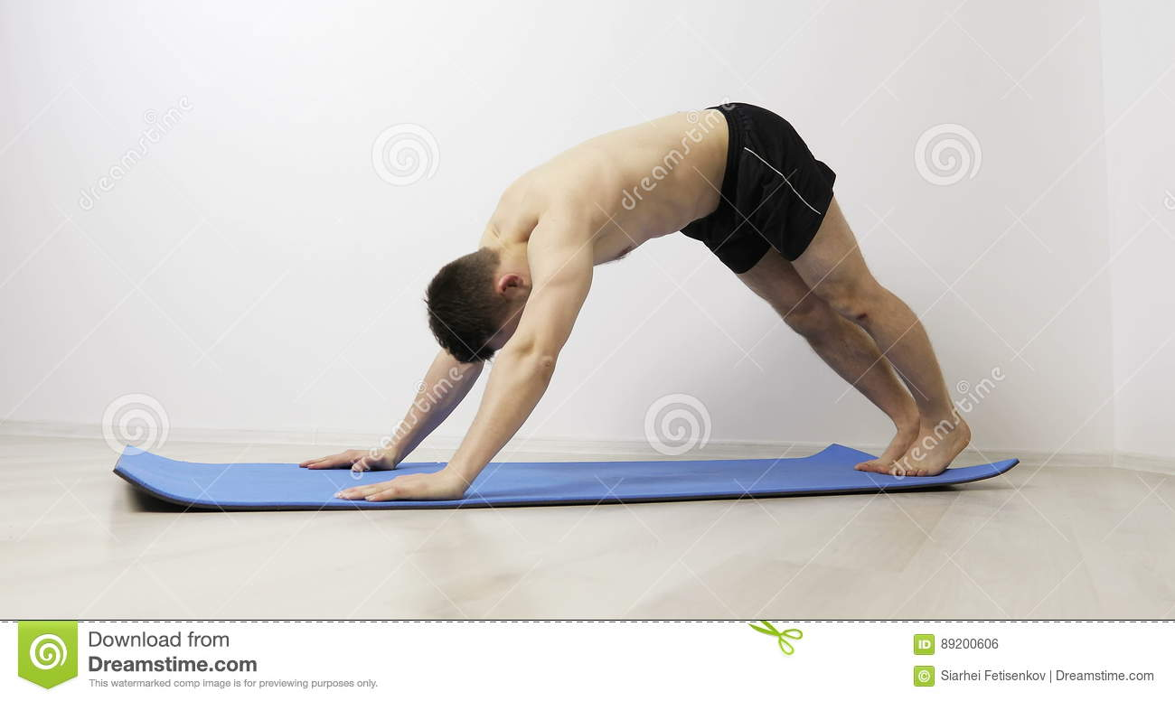 Young Man Practicing Advanced Yoga Poses Stock Footage