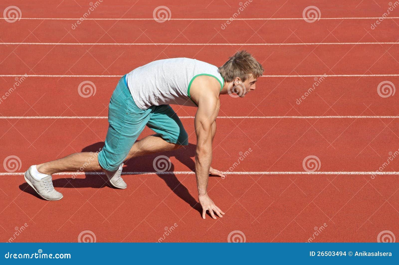 Young man preparing to run