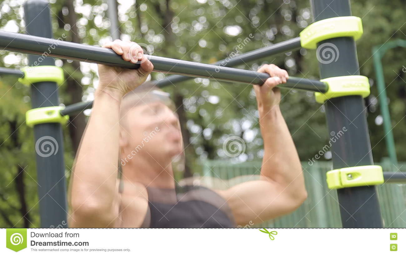 Young Man Pull Ups Bars Workout Exercise Stock Footage