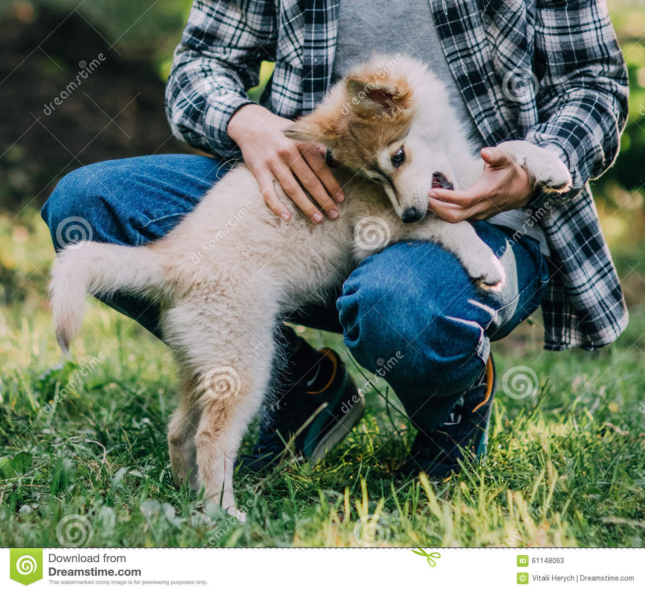 Young man with puppy