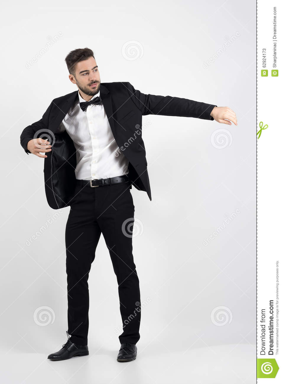 Young Man Putting On Black Suit Tuxedo Coat. Stock Image