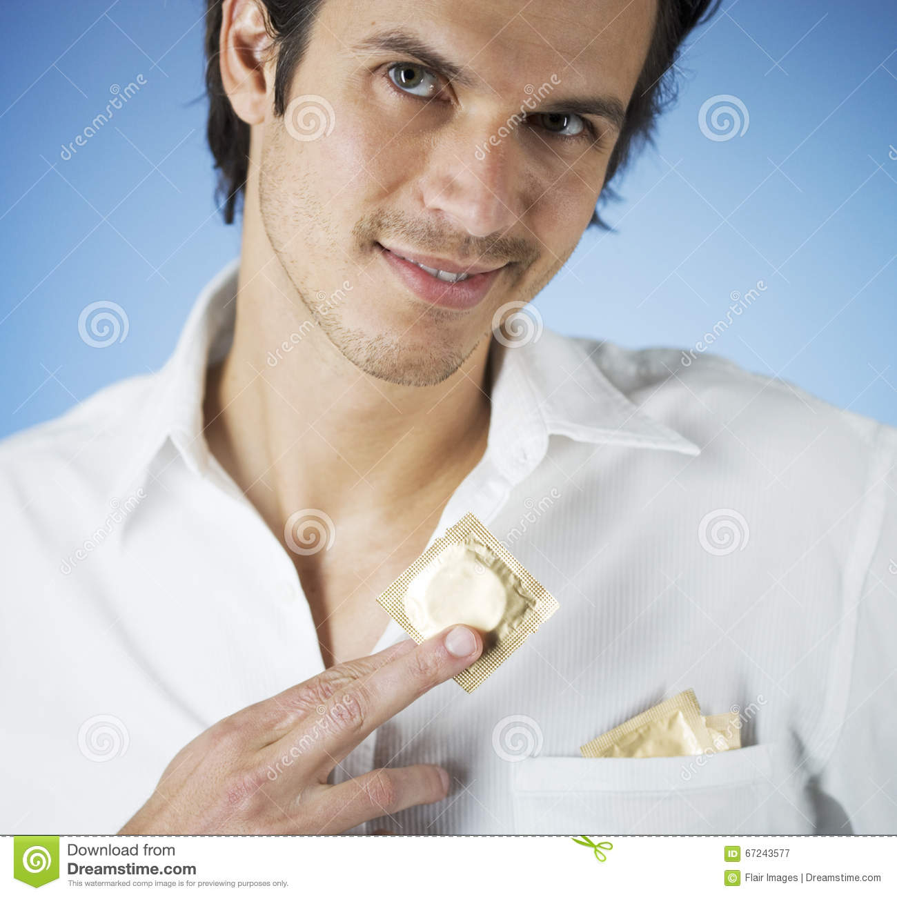 A Young Man Putting Condoms In His Shirt Pocket