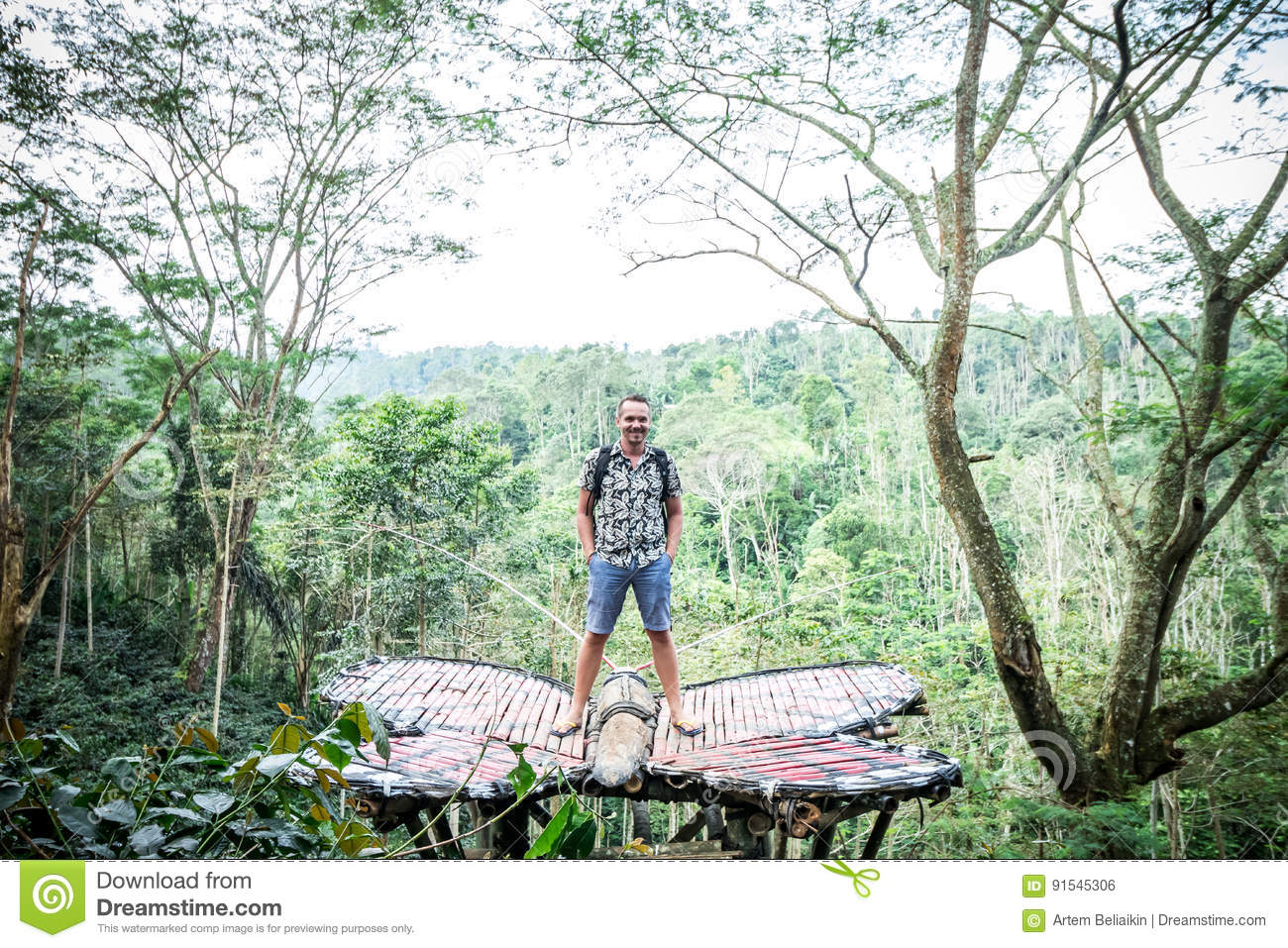 Young man in rainforest of tropical Bali island, Indonesia.