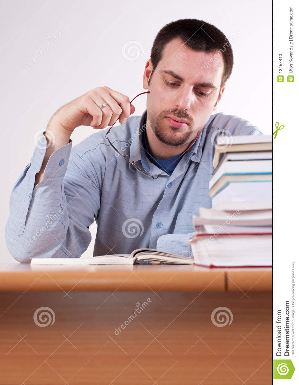 Young Man Reading Book, Learnin On The Table Stock Photo