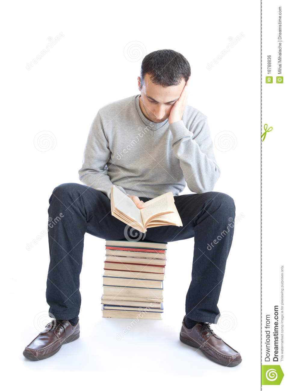Young Man Reading A Book On White Background Royalty Free