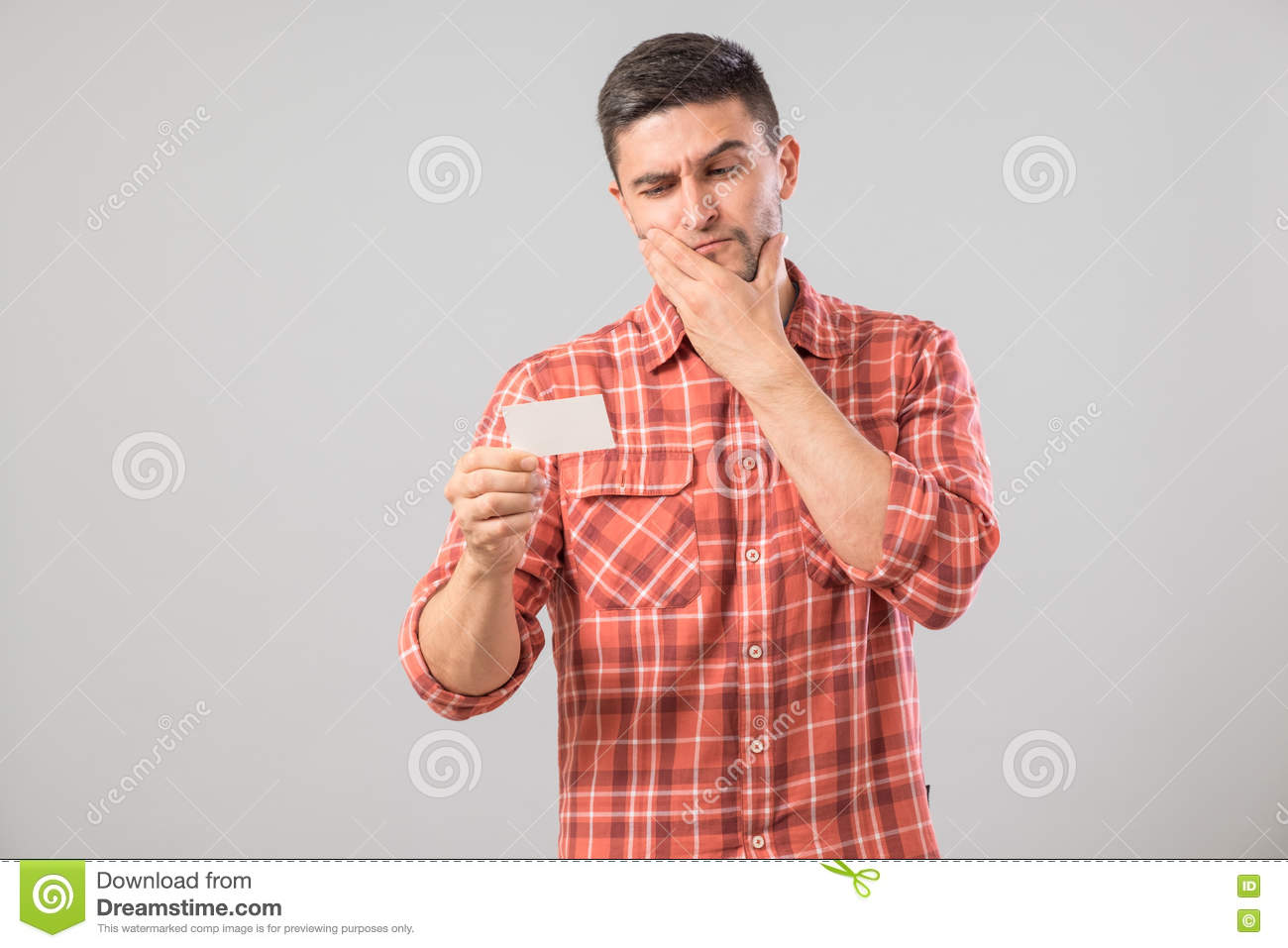 Young Man Reading Business Card Stock Image - Image: 74806655