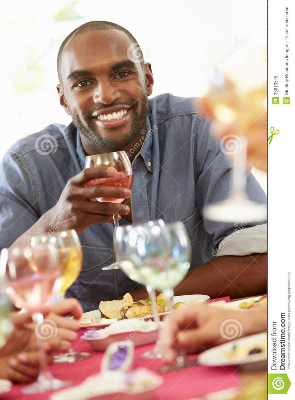 Download Young Man Relaxing At Dinner Party Stock Photo - Image of looking, drink: 35610576
