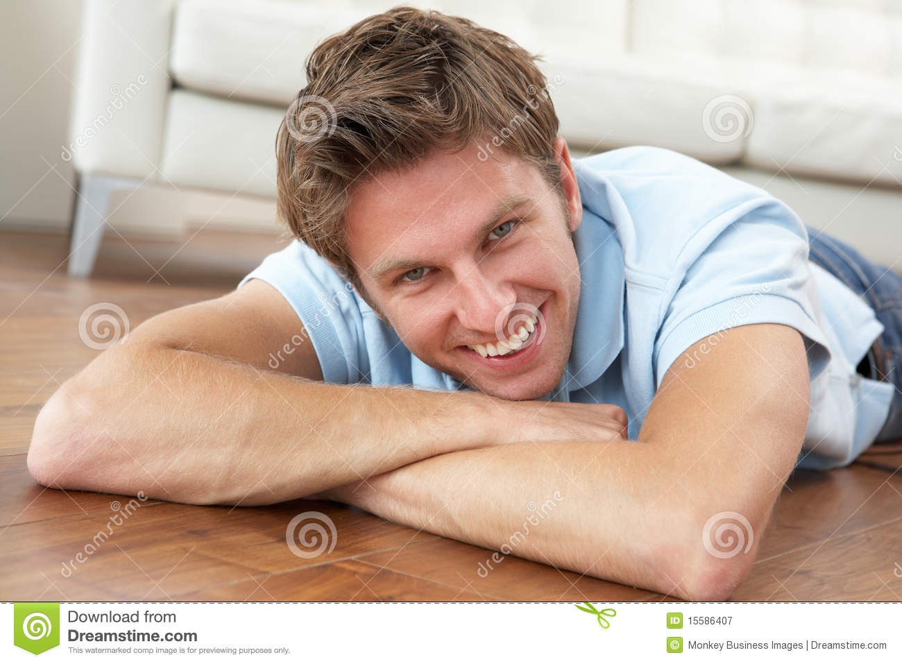 Young Man Relaxing At Home Royalty Free Stock Photography