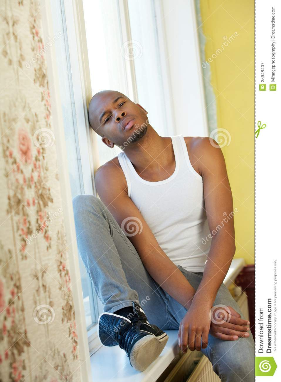 Handsome Man Sitting At Home Next To Window Royalty Free