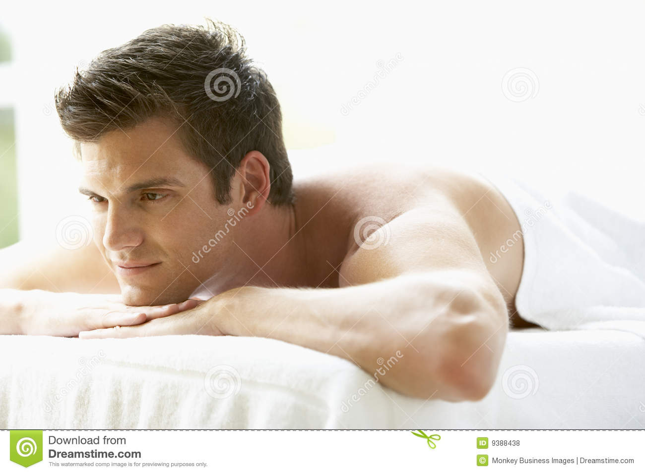 Young Man Relaxing On Massage Table Royalty Free Stock
