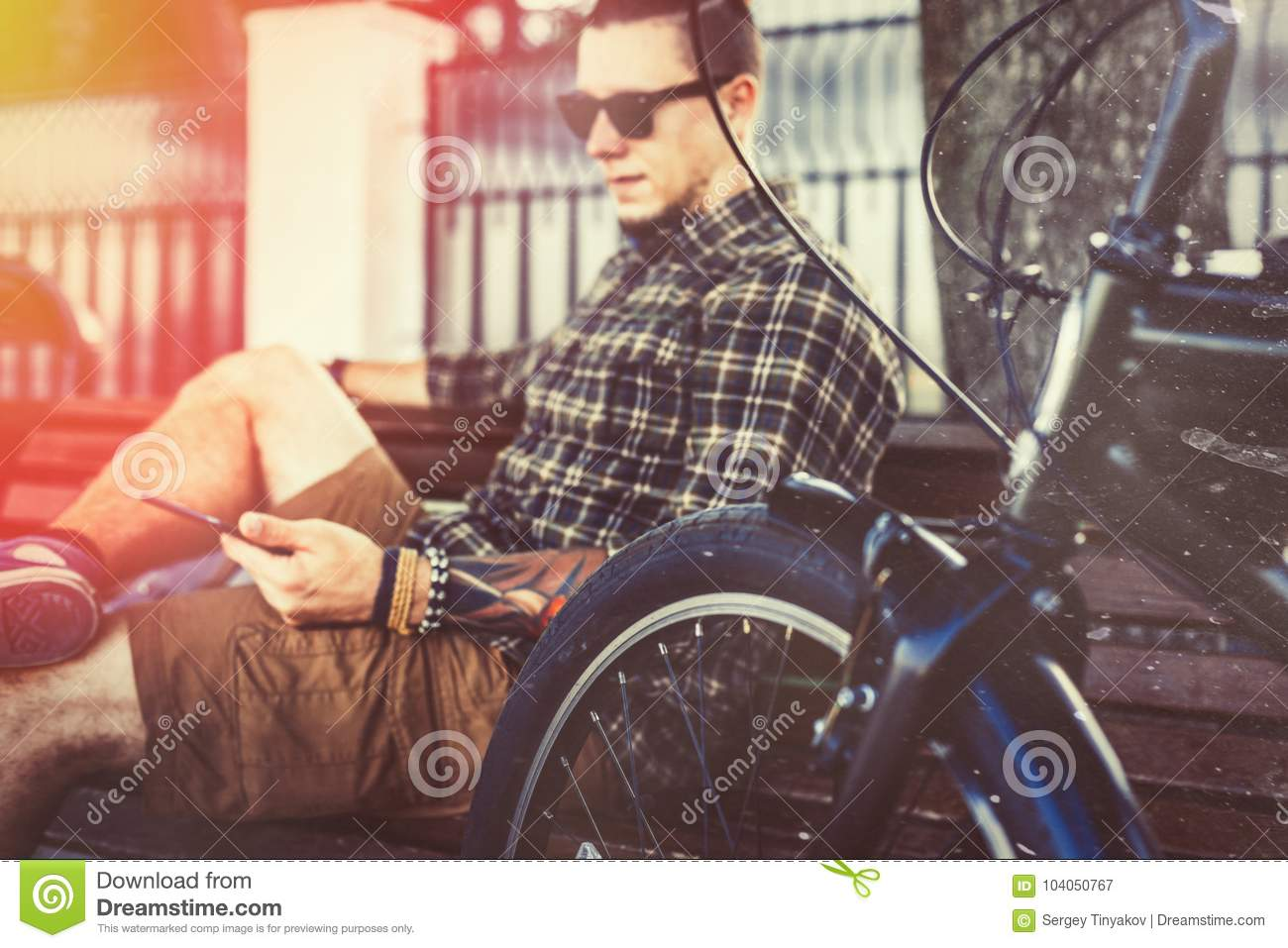Young Man Resting On Bench And Using Tablet, Toned And Scratches