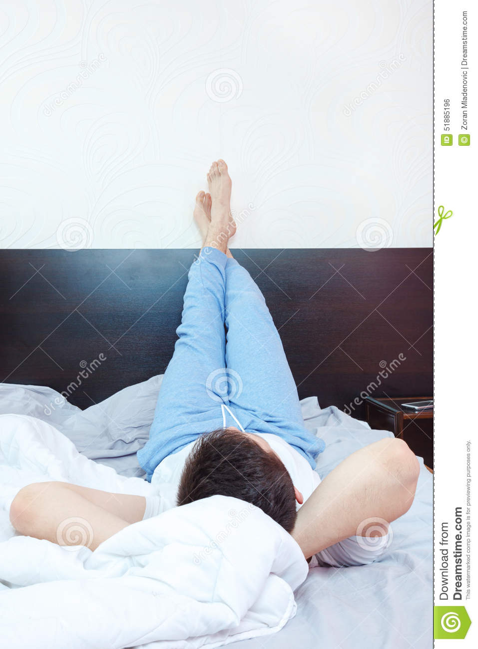 Young Man Resting Chillout Or Sleeping In Bedroom Stock