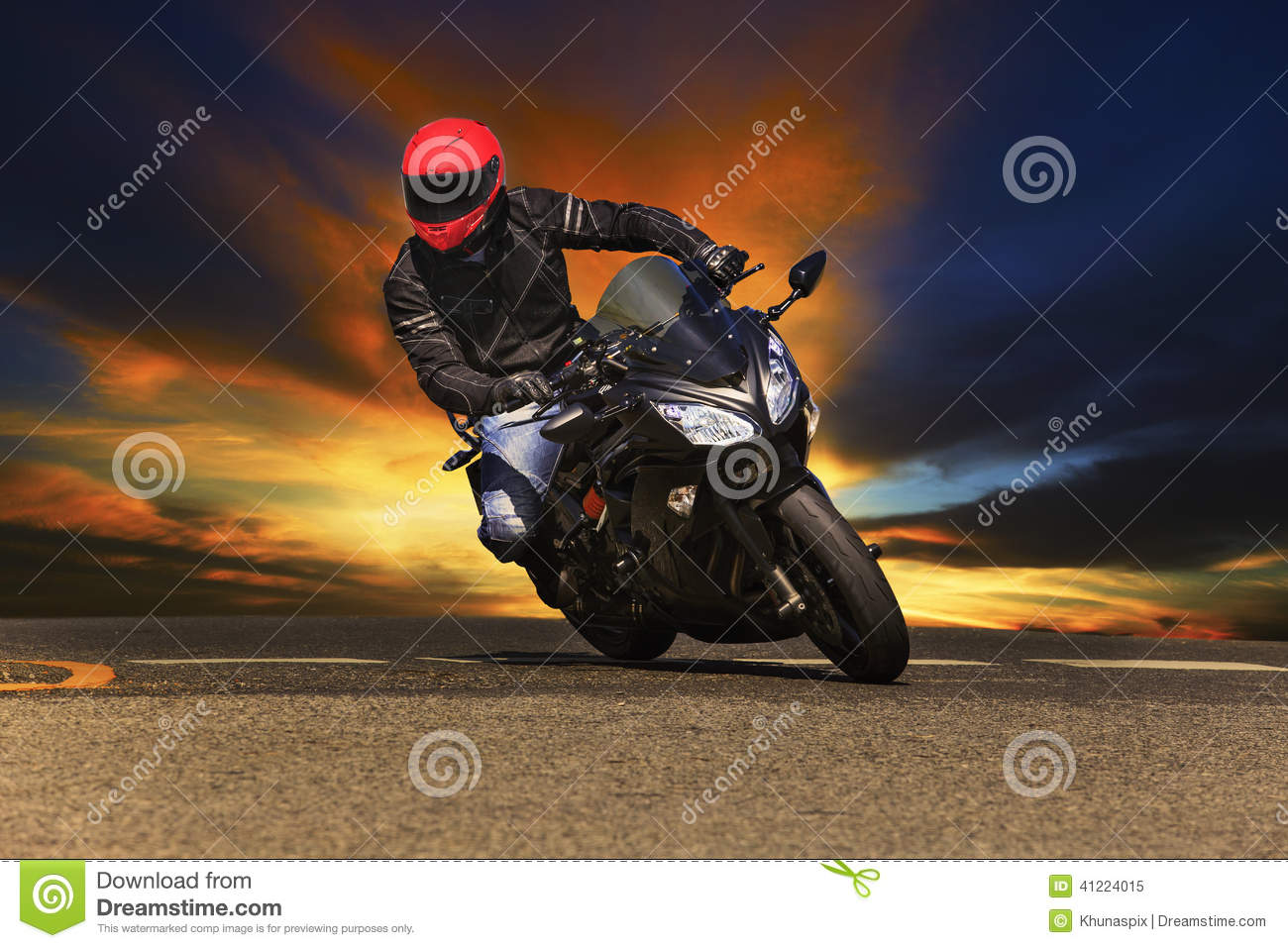 Young man riding big bike motorcycle on asphalt roads