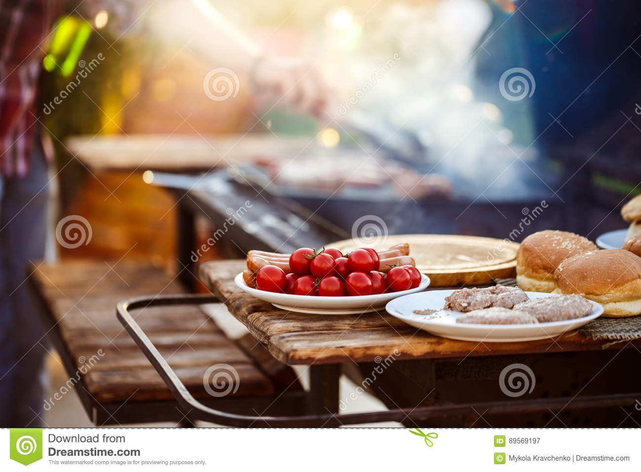 man at a barbecue grill royalty free stock image. Black Bedroom Furniture Sets. Home Design Ideas