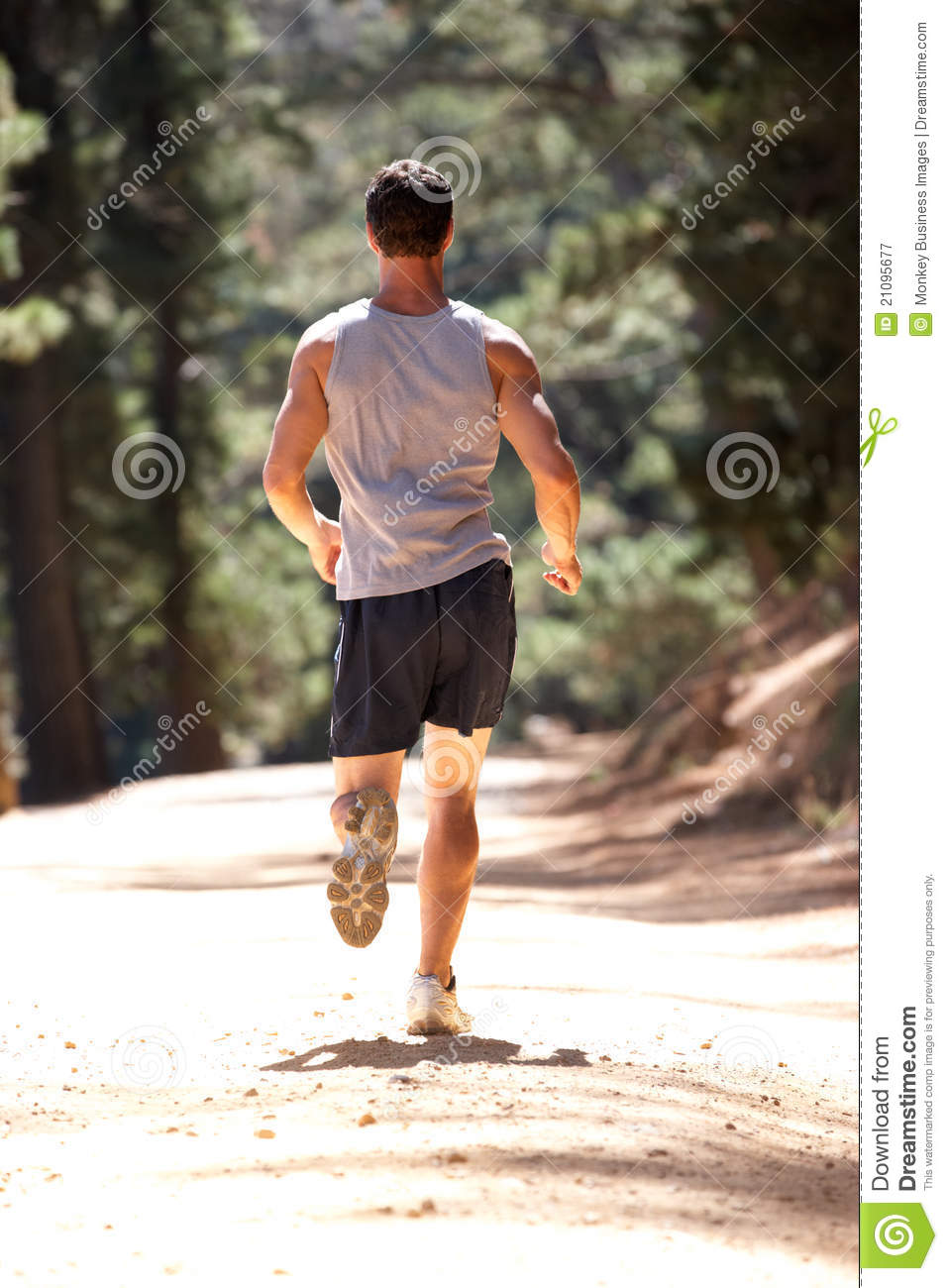 Young Man Running Along Country Lane Royalty Free Stock ...
