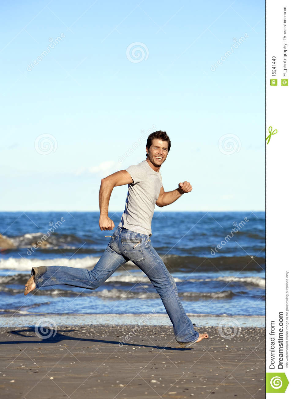 Young Man Running Barefoot On Beach Royalty Free Stock ...